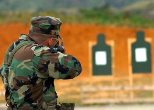 A seabee fires a M-16 rifle during live fire qualifications Poster Print by Stocktrek Images