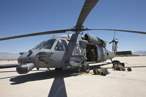 HH-60G Pave Hawk with pararescuemen equipment at Davis-Monthan Air Force Base during exercise Angel Thunder 2013 Poster Print