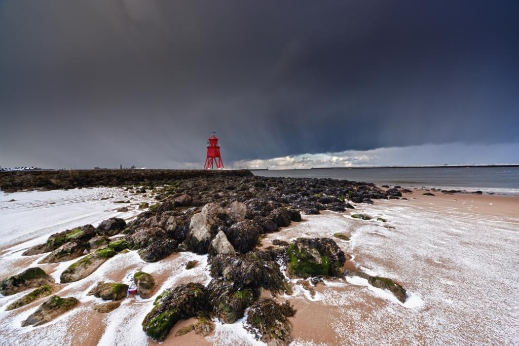A Red Lighthouse Along The Coast Under A Stormy Sky; South Shields, Tyne And Wear, England PosterPrint