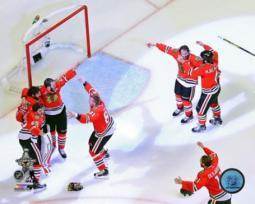 The Chicago Blackhawks celebrate winning Game 6 of the 2015 Stanley Cup Finals Sports Photo PFSAASB14201