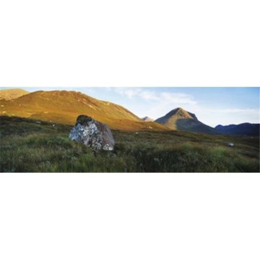 Panoramic Images PPI108176L Lichen covered rock in a field Glen Sligachan Cuillins Isle Of Skye Scotland Poster Print by Panoramic Images - 36 x 1