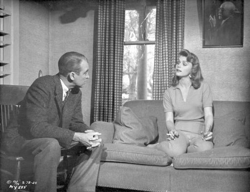 Anatomy Of A Murder Woman Talking to a Guy While sitting on the Sofa in a Movie Scene in Black and White Photo Print
