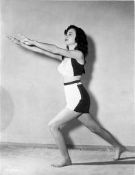 Carol Forman on Midriff with Hands Forward and Bending Leg Photo Print GLP466113