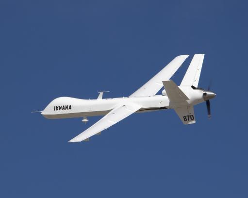 March 5, 2007 - Its white surfaces in contrast with the deep blue sky, the Ikhana unmanned science and technology development aircraft soars over.