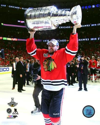 Marcus Kruger with the Stanley Cup Game 6 of the 2015 Stanley Cup Finals Photo Print NQYA8YUPD3L0HVWS