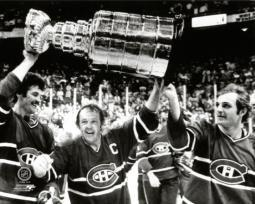 Yvan Cournoyer #12  hoist the Stanley Cup Trophy with help from teammates Yvon Lambert #10 and Guy Lafleur #10 of the Montreal Canadiens, after defeating the Boston Bruins at the Boston Garden on May 25, 1978 Photo Print PFSAAME08901