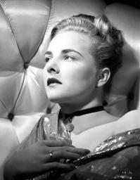 Leza Holland on a Silk Top Lying on a Couch Portrait Photo Print GLP467498