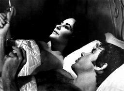 Film still of Elizabeth Taylor and Warren Beaty in bed in The Only Game in Town Photo Print GLP353679LARGE