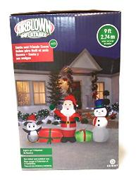 At Home Inflatable Christmas Santa, Gifts, Snowman, And Penguin Lighted Yard Display 9 Feet Long