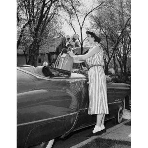 Posterazzi SAL2558893 Young Woman Putting a Golf Bag in a Car Poster Print - 18 x 24 in. WE8BLG0H3AXP4VQA