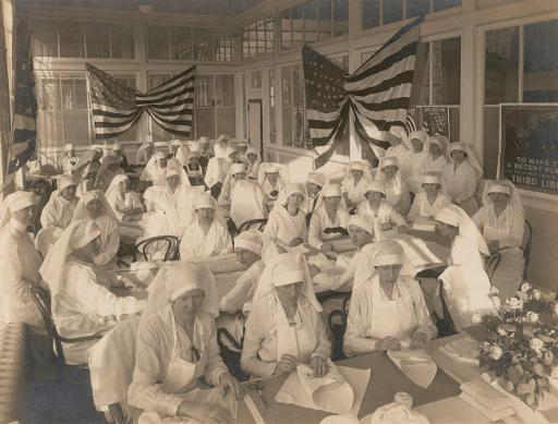Office workers volunteering to pack bandages for the American Red Cross, 1919 Poster Print by Stocktrek Images