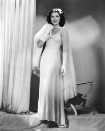 Jean Parker Modeling A White Chiffon Evening Gown With A Rhinestone-Buckled Cape And White Fox Throw 1937 Photo Print EVCPBDJEPAEC025HLARGE