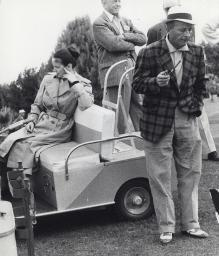 Bing Crosby and Larry Crosby with a golf cart Photo Print GLP348888