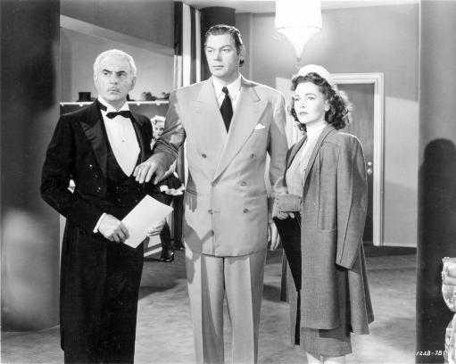 Johnny Weissmuller standing on the Office with an Old Man and a Lady in Classic Movie Scene Photo Print
