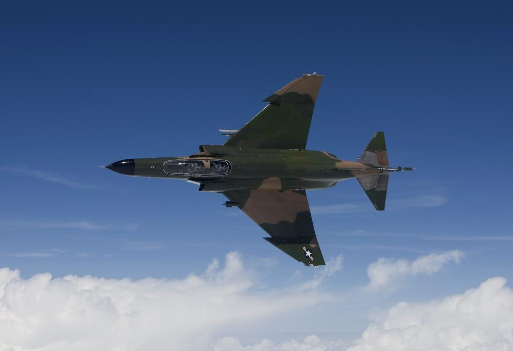 A QF-4E from the 82nd ATRS flies over the Gulf of Mexico during a training sortie out of Tyndall Air Force Base, Florida Poster Print