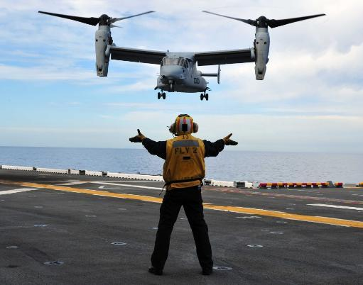 March 1, 2011 - An MV-22 Osprey tiltrotor aircraft approaches the flight deck of the amphibious assault ship USS Makin Island in the Pacific.