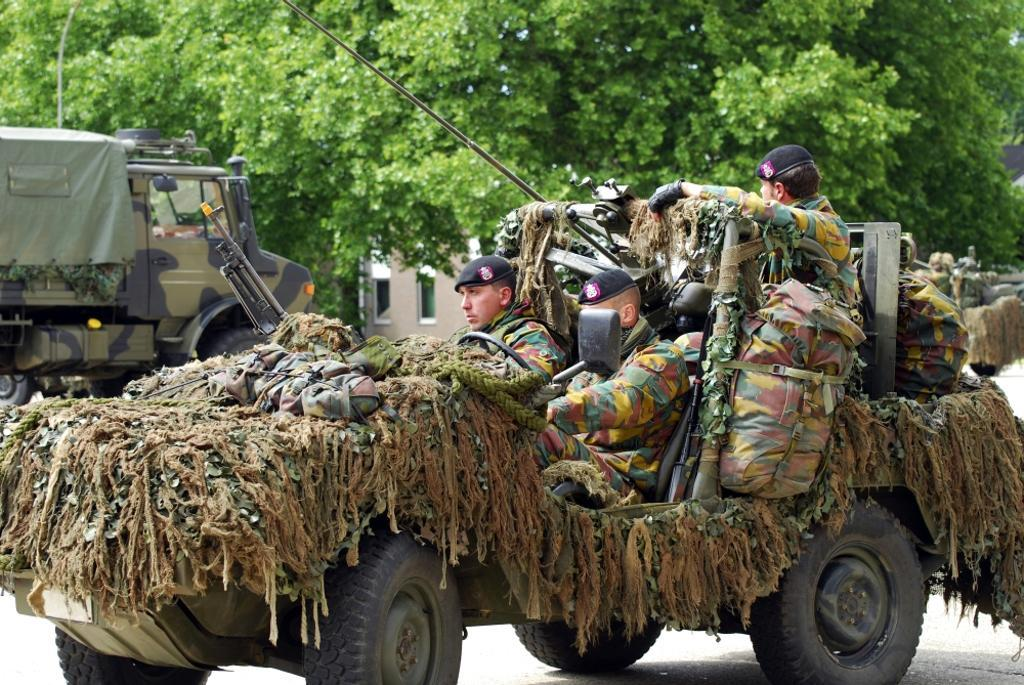 A recce or scout team of the Belgian Army in their VW Iltis jeeps in action Poster Print