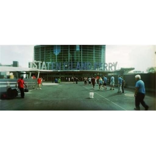Commuters in front of a ferry terminal Staten Island Ferry New York City New York State USA Poster Print by - 36 x 12