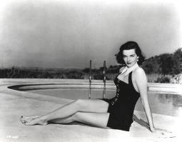Jane Russell Reclining on the Pool in Black One Piece Swimsuit and White Collar with Legs Crossed Photo Print GLP454915LARGE