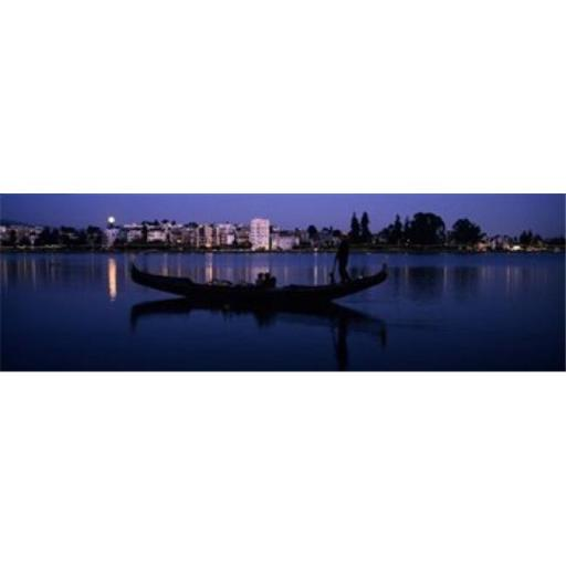 Panoramic Images PPI131116L Boat in a lake with city in the background Lake Merritt Oakland Alameda County California USA Poster Print by Panoram