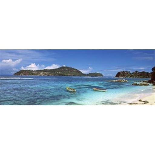 Small fishing boats on Anse LIslette with Therese Island in background Seychelles Poster Print by - 36 x 12