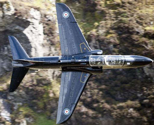 A Hawk jet trainer aircraft of the Royal Air Force low flying over North Wales Poster Print