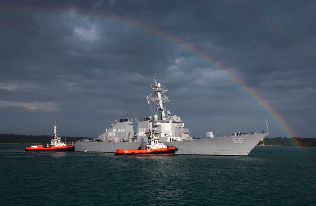 A rainbow arches over the guided missile destroyer USS Gonzalez Poster Print by Stocktrek Images