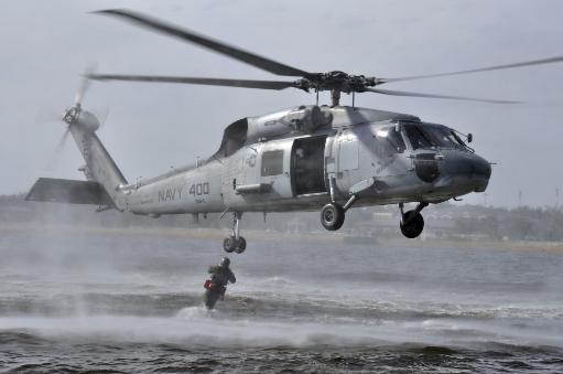Pensacola, Florida, March 30, 2009 - A search and rescue swimmer jumps from an SH-60F Sea Hawk helicopter Poster Print
