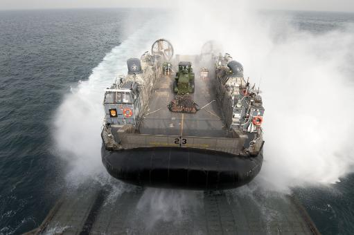 Arabian Gulf, February 18, 2012 - A landing craft air cushion enters the well deck of the amphibious dock landing ship USS Pearl Harbor. Poster Print