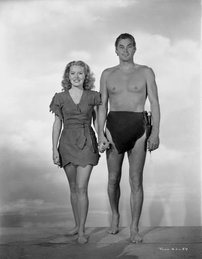 Johnny Weissmuller Taking a Picture with a Woman while Holding Hands in a Classic Movie Scene Photo Print