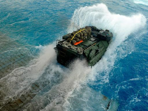 An amphibious assault vehicle exits the well deck of USS Fort McHenry Poster Print by Stocktrek Images
