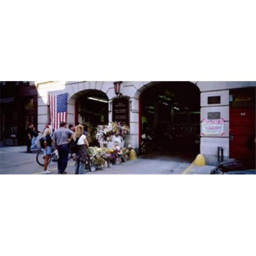 Panoramic Images PPI76199L Rear view of three people standing in front of a memorial at a fire station New York City New York State USA Poster Prin