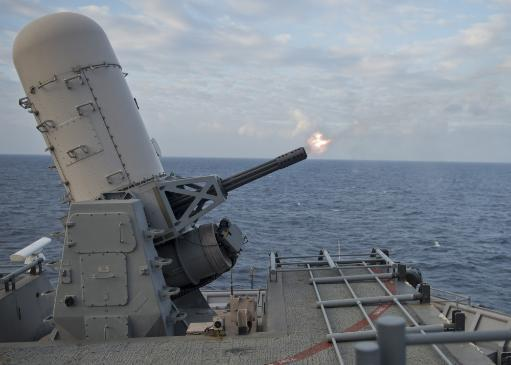 East China Sea, February 1, 2013 - A close-in weapons system fires from the Whidbey Island-class amphibious dock landing ship USS Tortuga during a.