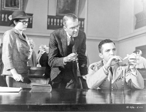Anatomy Of A Murder Woman Watching the Two Men Testing an Evidence in a Movie Scene in Black and White Photo Print