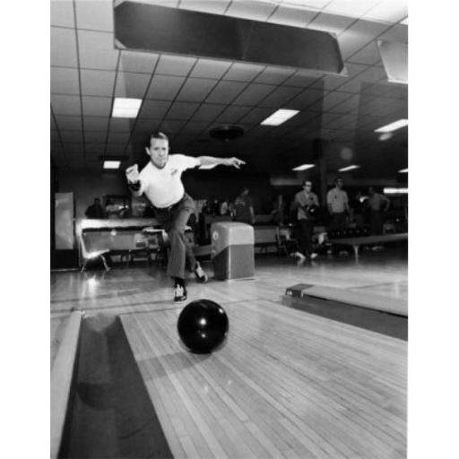 Posterazzi SAL9903156 Mid Adult Man Rolling a Bowling Ball in a Bowling Alley Poster Print - 18 x 24 in.