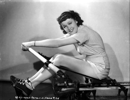 Pat Farr on Exercise Equipment smiling Portrait Photo Print