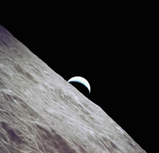 Crescent Earth Rises Above the Lunar Horizon Poster Print by Stocktrek Images