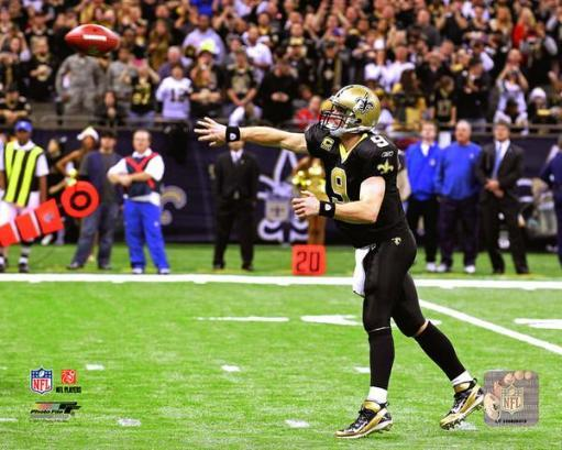 Drew Brees throws a touchdown pass to break the NFL single-season record for passing yardage against the Atlanta Falcons in New Orleans, December.