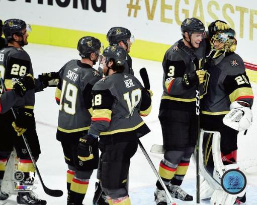 The Vegas Golden Knights celebrate winning their Inaugural Game at T-Mobile Arena on October 10, 2017 Photo Print