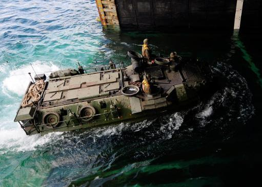 An amphibious assault vehicle enters the well deck of USS Germantown Poster Print by Stocktrek Images