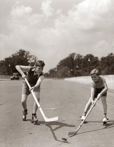 1930s-1940s 2 Boys With Sticks And Puck Wearing Roller Skates Playing Street Hockey Print By Vintage Collection