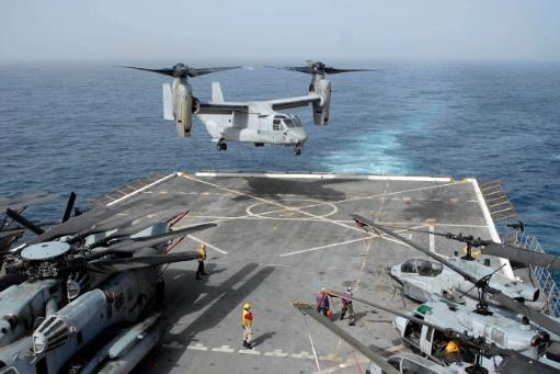 An MV-22B Osprey lands aboard the amphibious transport dock ship USS Mesa Verde Poster Print by Stocktrek Images