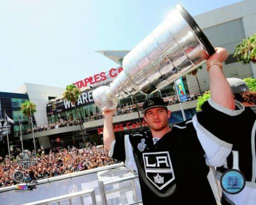 Jonathan Quick with the Stanley Cup Trophy during the Los Angeles Kings victory parade Photo Print SR4XKWUUIAHKSRZI