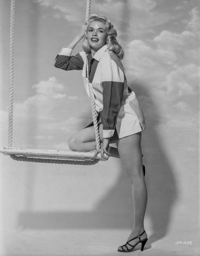 Jayne Mansfield Posed on the Swing in White Short Sleeve Collar Shirt and Black Long Sleeve Shirt with White Cuff Photo Print