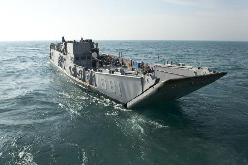 Arabian Gulf, January 27, 2012 - A landing craft utility departs the well deck of the amphibious dock landing ship USS Pearl Harbor during well.