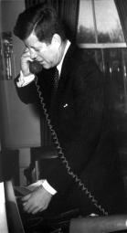 President John F Kennedy talking on a telephone Photo Print GLP451250LARGE