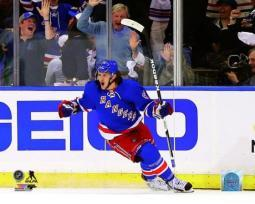 Carl Hagelin of the New York Rangers celebrates after scoring a goal in the first period during Game Four of the Eastern Conference Final in the 2014 NHL Stanley Cup Playoffs at Madison Square Garden on May 25, 2014. Photo Print PFSAAQY00501