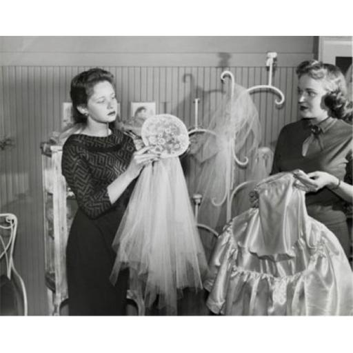 Posterazzi SAL25543579 Mid Adult Woman with Young Woman Holding Dresses in Clothing Store Poster Print - 18 x 24 in.