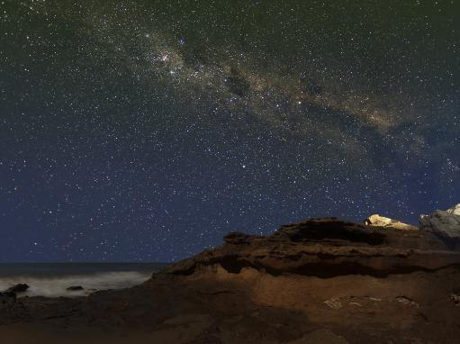 The Milky Way showing the figure known as The Emu rising over the cliffs in Miramar, Argentina Poster Print