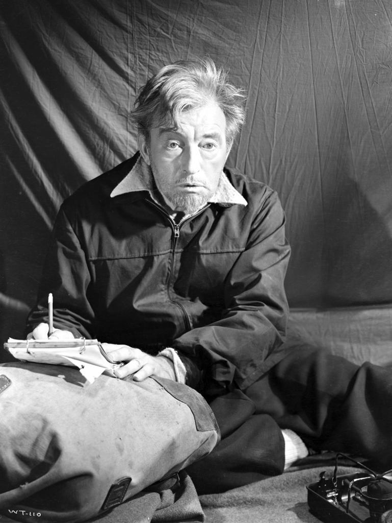 A Promotional Still Of Claude Rains Writing A Letter Photo Print